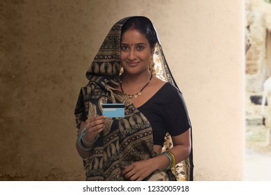 Portrait of rural woman holding credit card