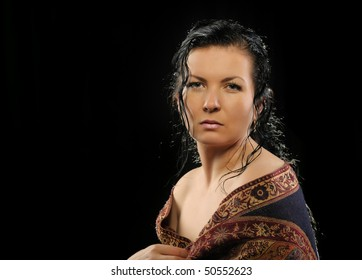 Portrait of the Russian attractive woman with a shawl. A black background