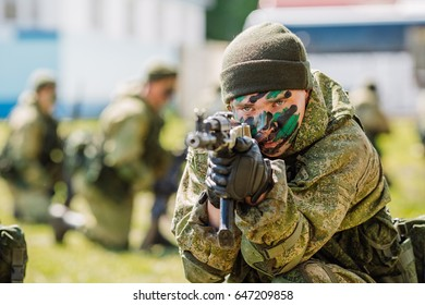 Portrait of a Russian special forces  soldiers in modern military uniforms with weapons. Military, war, conflict, soldiers concept