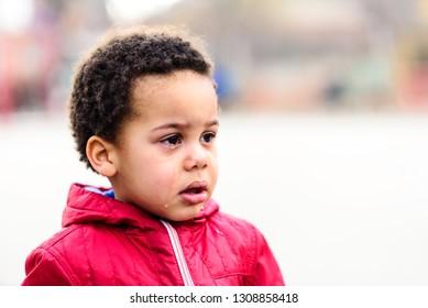 portrait of a sad boy crying