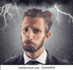 Portrait of sad businessman with storm background