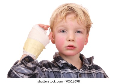 Portrait of a sad child with his hand hurt