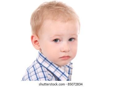 portrait of sad child over white background, close up