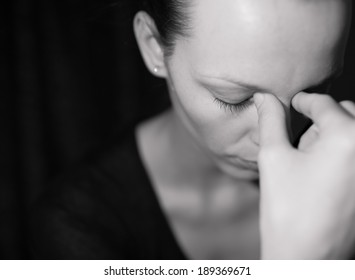 Portrait of sad and depressed woman deep in thought. Child abuse.