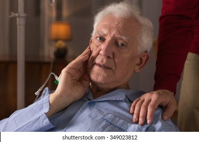 Portrait of sad elderly man suffering from dementia