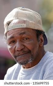 Portrait of sad eyes of old homeless man