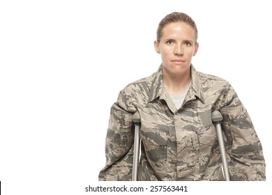 Portrait of sad female airman on crutches