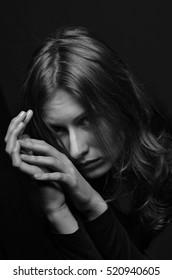 portrait of a sad girl. Black and white photo