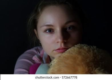 Portrait of the sad girl on a dark background