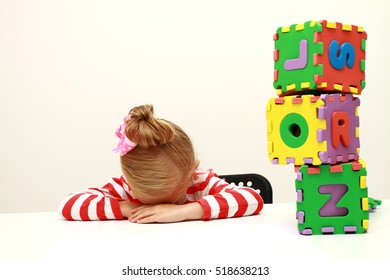 Portrait of sad girl putting her head on desk