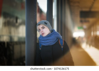 Portrait of a sad girl at the railway station