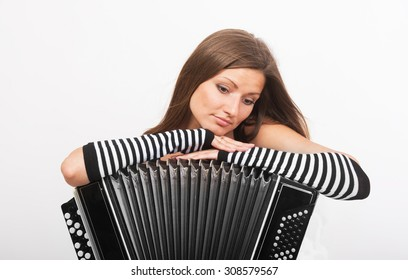 Portrait of a sad girl with the Russian bayan (button accordion)