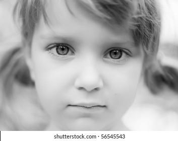 Portrait of a sad liitle girl close-up