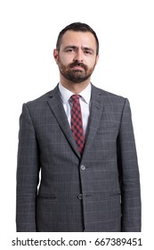 Portrait of sad looking business man with suit and tie.