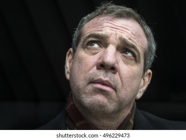 Portrait of a sad middle-aged man looking up.
