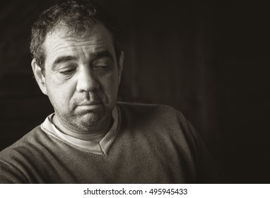 Portrait of sad, middle-aged men. Black and white photo
