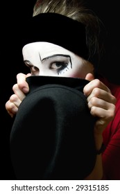 Portrait of the sad mime with a hat