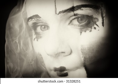 Portrait of the sad mime in a veil