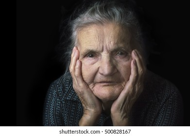 Portrait of a sad, nostalgic elderly woman. Evoking the past and worrying about the future. Selective focus.