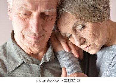 Portrait of  sad senior couple close up