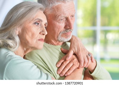 Portrait of a sad senior couple posing at home