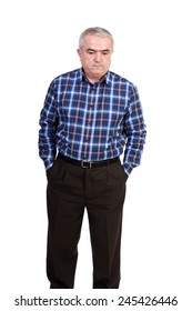 Portrait of sad senior man with hands in his pockets looking down isolated over white background