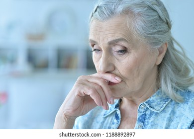 portrait of sad senior woman at home