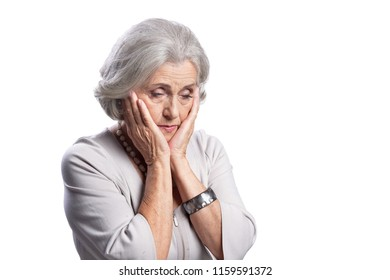 Portrait of a sad senior woman isolated