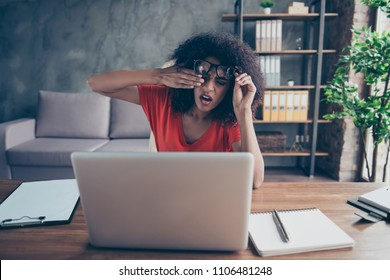 Portrait of sad upset freelancer feeling unwell rubbing eyes because of strain tired from laptop sitting in modern comfortable office with interior. Oculist ophthalmologist optical optician concept