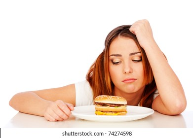 portrait of sad woman with burger over white background