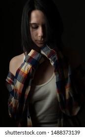 Portrait of sad young woman. Low key