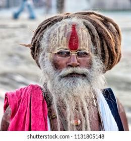 PORTRAIT OF A SADHU, ALLAHABAD, INDIA - FEBRUARY 14, 2013: A Sadhu attending the world's largest religious hindu gathering of Kumbh Mela.