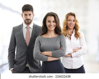 Portrait of sales team standing at office.