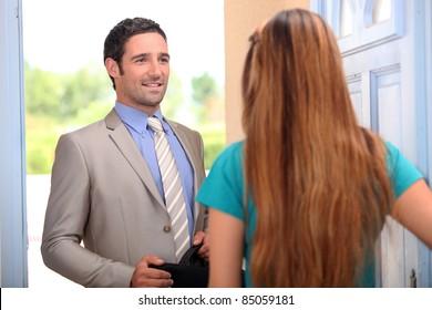 portrait of a salesman with client