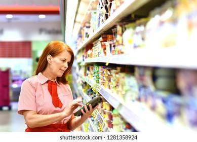 portrait of a saleswoman in the supermarket