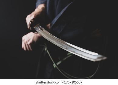 Portrait of samurai holding japanese sword