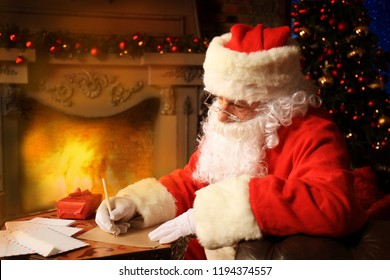 Portrait of Santa Claus answering Christmas letters.