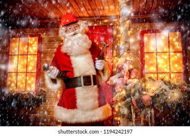 Portrait of Santa Claus in helmet repairing his home. Christmas and New Year concept.