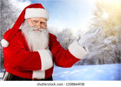 Portrait of santa claus on winter nature background