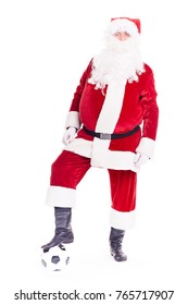 Portrait of Santa Claus playing soccer ball on white background