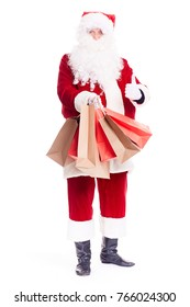 Portrait of Santa Claus posing with bunch of shopping bags on white background