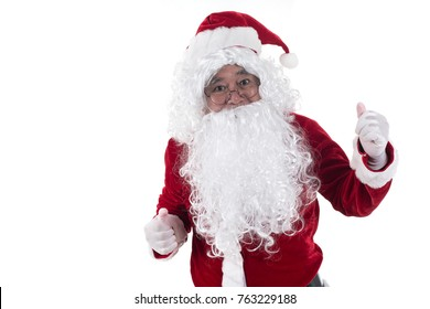 Portrait of Santa Claus standing with thumbs up isolated on white background