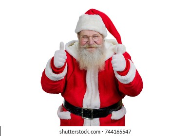 Portrait of Santa giving thumbs up gesture. Smiling Santa Claus giving thumb up gesture with both hands on white background. Studio shot of cheerful Santa with ok sign.