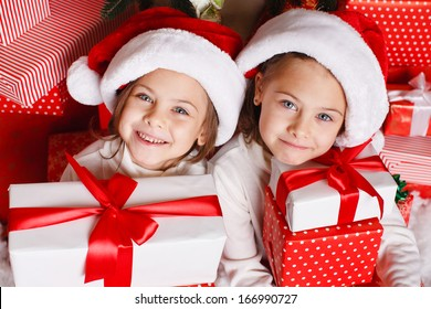 b1d55621bf050 Portrait of Santa hat Christmas girls holding christmas gifts smiling happy  and excited. Cute beautiful