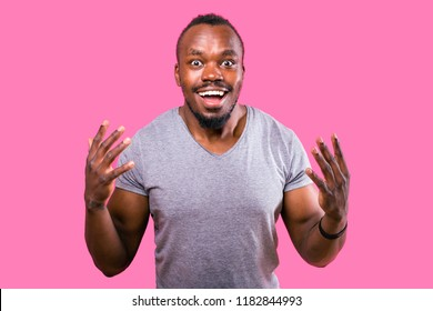 Portrait of a satisfied African man on a pink background