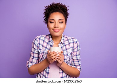 Portrait of satisfied charming lady people take mug hot beverage have weekend free time holidays wear checkered shirt top-knot isolated on purple background