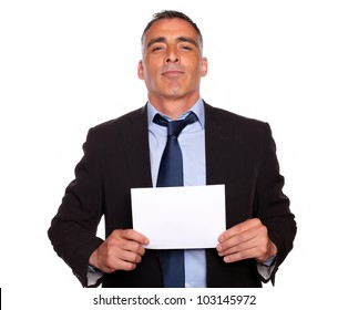 Portrait of a satisfied senior executive man holding a white card with copyspace on isolated background