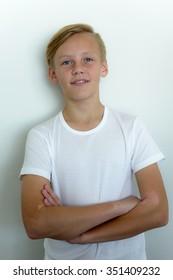 Portrait of Scandinavian blonde teenager boy smiling