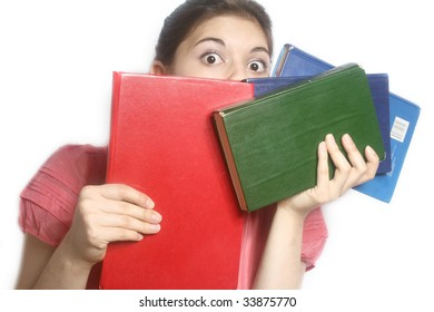 Portrait of the scared girl with books in hands.