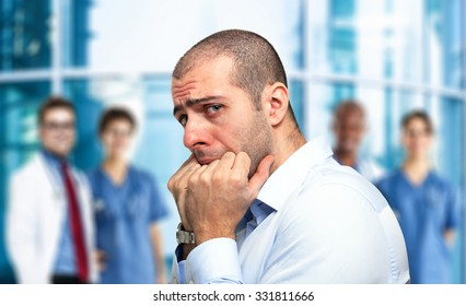 Portrait of a scared guy in front of an hospital